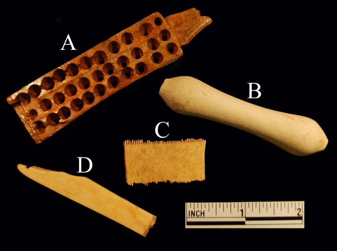 "Artifacts from Ferry Farm related to eighteenth-century hair care.  A) A woman's bone hair brush, used on natural (not wig) hair.  B) An earthenware wig hair curler, made c. 1740-1780.  C)  A bone grooming or ""lice"" comb.  D)  A bone razor guard, used by men to shave their facial hair and to shave the head to accommodate a tight-fitting peruke."