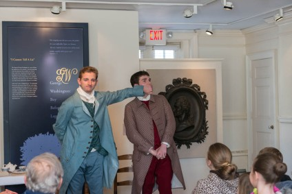 Actors Scott Houk and Will Goldstein demonstrate how gentlemen were not to behave in George Washington's day.