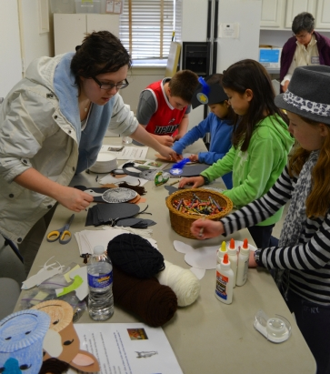 Young visitors enjoy making one of George Washington's horses...