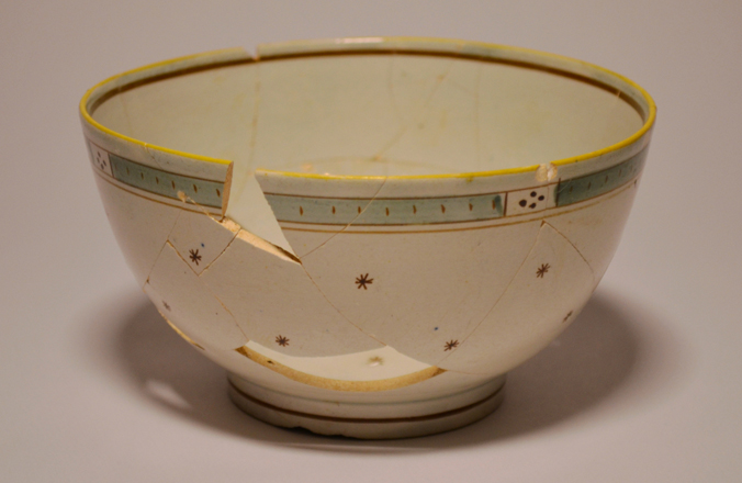 Pearlware waste or 'slop' bowl. Hand painted. Made in England between 1795 and 1830.  This bowl would have been used during the tea ceremony as a receptacle for spent tea leaves or unwanted cold tea before refilling a cup with hot tea.