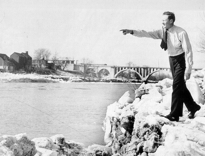 """Walter """"Big Train"""" Johnson poses for the press on the day he threw a silver dollar across the Rappahannock River... twice."""