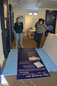 Proofing the new exhibit text a final time before hanging.