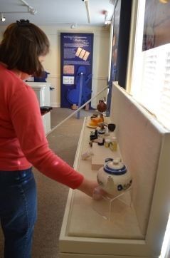 Placing the objects back on display.