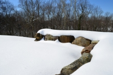 Snow-covered stones marking one corner of the Washington's house site.