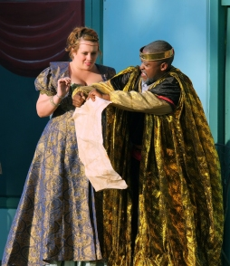 After her false declaration of love, Lear gives Regan (Amy Wolf) her portion of the kingdom.