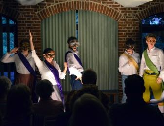 Actors present the prologue.