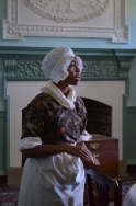 Hetty (Ashleé James), an enslaved house servant and washerwoman owned by the Lewises, debates whether to runaway to the British, who promised freedom to slaves and indentured servants that belonged to Patriots.