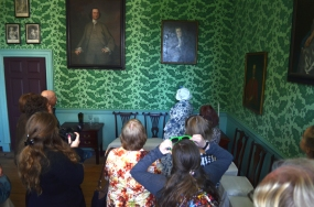 Betty Washington Lewis (Barbara Cochran) shows visitors her home and talks about the family she and Fielding have built.