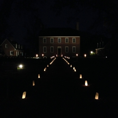 The Kenmore grounds lit by lanterns and luminaries.