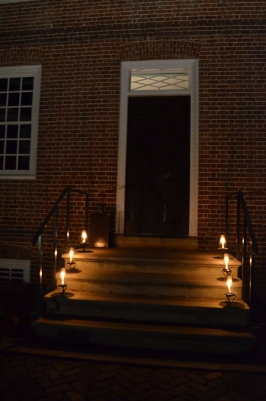 Lanterns light the steps into the mansion.
