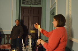 Meghan demonstrates how colonial Americans carried their candles as they moved around a dark house.
