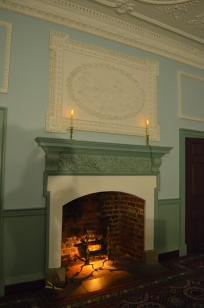 Eventually, the modern electric lighting was extinguished, leaving only the replica candles and fireplace to light the room.