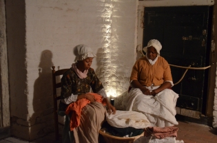 In a theater skit, two enslaved women owned by Fielding Lewis are up in the middle of the night. Hetty, a washerwoman and house servant, and Rachel, a cook, do extra laundry to earn money and fund an attempt to runaway.