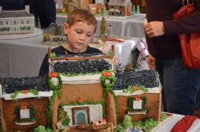 Young visitor looks one of the gingerbread houses.