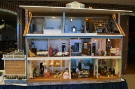 """Baxter House"" submitted by James Opher, Julie Silvester, owner of Lilliput's Doll House Shop, and Traci Haden, president of Virginia Minature Enthusiast Region E-1. Originally built by Mr. & Mrs. Baxter the house has over 16 rooms including a Grand Ballroom."