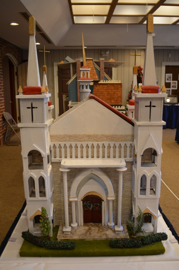 """""""Place of Worship"""" submitted by James Opher has features to represent the Catholic, Islamic, Methodist, and non-demoninational faiths."""