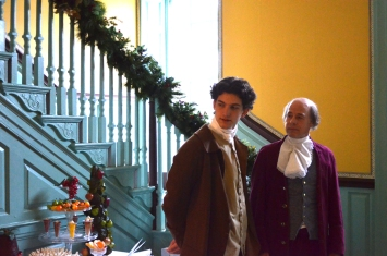 George Weedon (Sam Fulton) and Fielding Lewis (John Hollinger) remark upon the Christmas decorations.