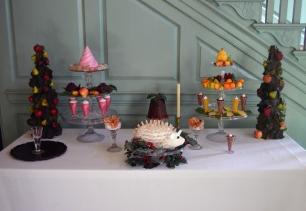 The dessert table includes a hedgehog cake.