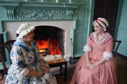 Betty Washington Lewis (L-Barbara Cochran) and Nancy Alexander Lewis (R-Corinn Keene) determine to smile through the troubles of war.
