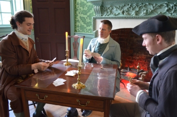 Captain Taylor, John Lewis (Mike Taylor), and George Lewis play cards.