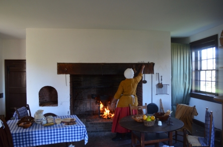 Rachel (Gladys Perkins), enslaved cook for the Lewis family, tends the fire.