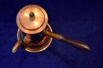 This cooper chocolate pot was made sometime between 1750-1770 in England or America.