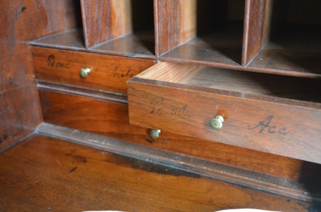 Drawers with the shopkeeper's markings.