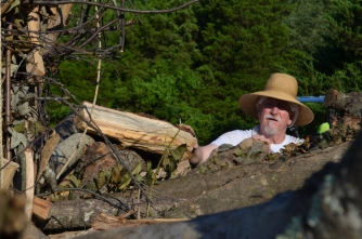 Bill Neff adds some smaller firewood.