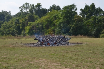 12:30 p.m. - As the wood burns, the pile gets ever smaller.