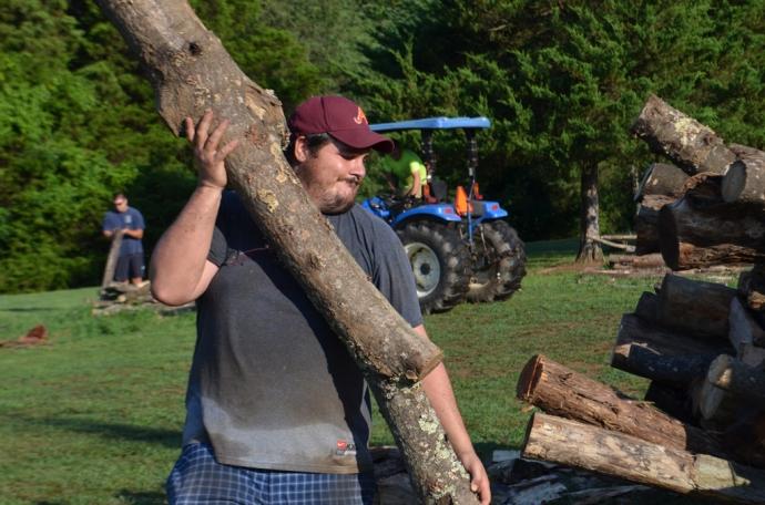 Kenneth Tappan throws a log...