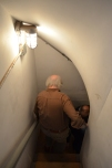 Descending a winding, narrow staircase into the underground HVAC control room.