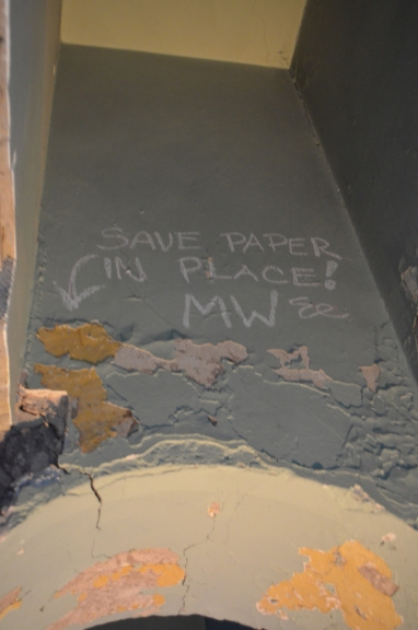 The slave passage features original paint and wallpaper. A message in chalk orders staff and future preservationists to save the 240-year-old wallpaper in place.