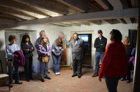 The group visited the cellar that was used as storage during the Lewis's days. Educational programs for visiting field trips take place, in part, in this space today.