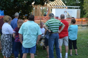 Visitors hear about the timber framing work.