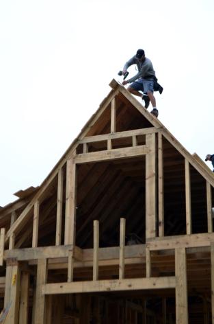 Placing roof sheathing.