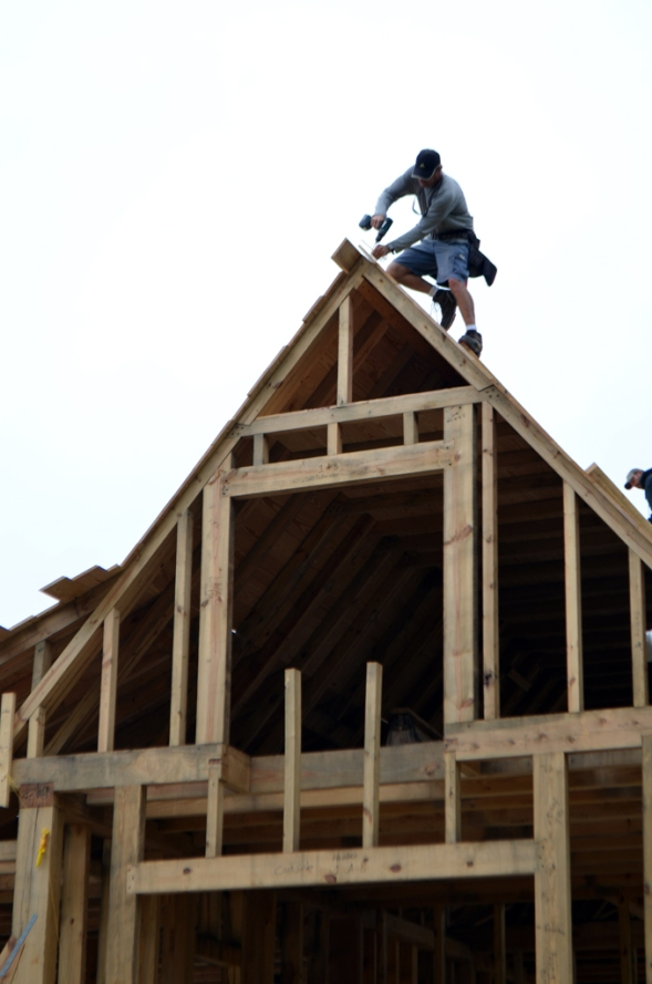 Placing roof sheathing.