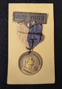 "Medal featuring a right-facing bust of Washington that was awarded by the New York State George Washington Bicentennial Commission ""in appreciation of Services generously Rendered to the Commission During 1932."" The accompanying card is signed by Charles Tobin, the commission's chairman."