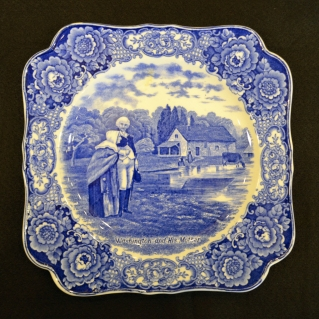 A Washington Bicentenary Memorial Plate from 1932 made by Crown Ducal in Stoke-on-Trent, England. This ceramic plate with blue transfer-print was part of a series of 12 to commemorate the 200th anniversary of Washington's birth. It imagines General Washington and Mary, his mother, strolling through a romanticized rural landscape.