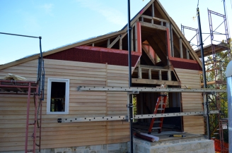 North side of the house receives its weatherboard.