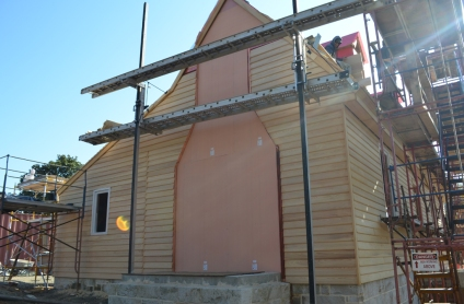 Completed weatherboard on the house's north side.