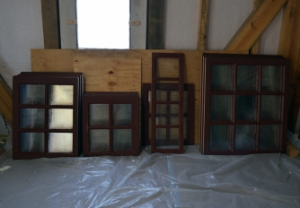 Glass waiting to be installed in the frames.