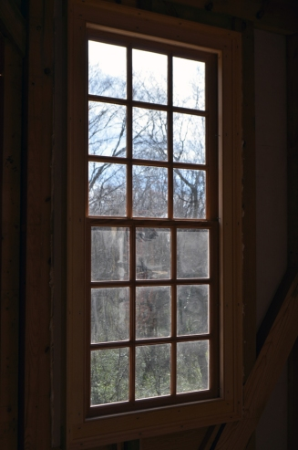 View from inside through one of the windows on the house's south side.