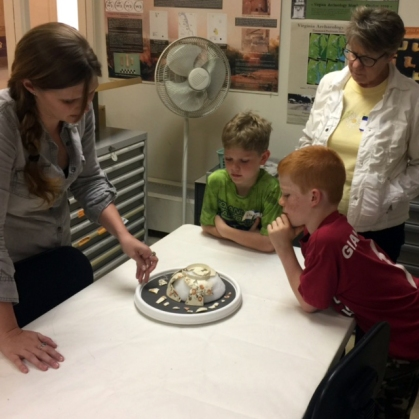 Viewing Mary Washington's punch bowl during an Archaeology Lab tour.