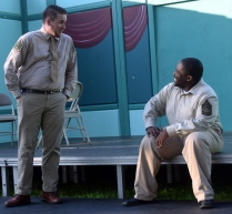Claudio (l-John Flemming) talks with Don Pedro (r-Marcus Salley) about how he is smitten with Hero.