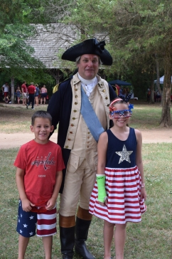 George Washington (Greg Fisher) greets young visitors.