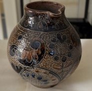 A 20th century earthenware jug decorated in great Westerwald style. We found this one in a shop that specializes in Asian antiques. Go figure!