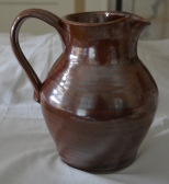 A perfect example of a reproduction redware pitcher!