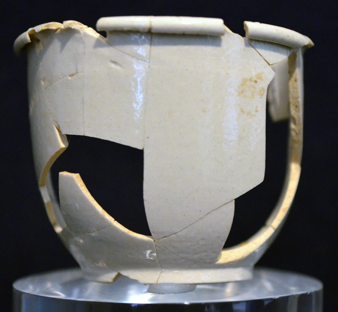 Three white salt glazed stoneware ointment pots excavated from the Washington house cellar at Ferry Farm.