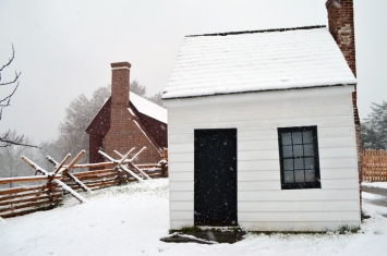 "Actually built after the Civil War, the ""Surveyor's Shed"", incorrectly thought to be Washington's surveying office, stands next to the reproduction Washington house."