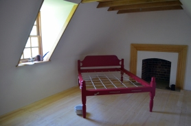 One of the upstairs bedrooms.